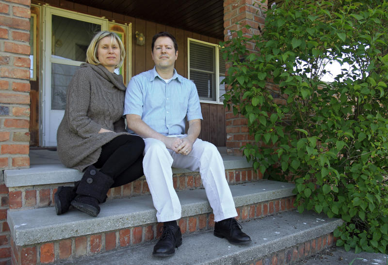 In this Tuesday, April 24, 2012 photo, Sarah and Devin Stang sit on the porch of the home they are renting in LaGrange, Ohio. The Stangs filed for bankruptcy and lost their Sandusky, Ohio home to foreclosure, but due to a 2005 lawtheir student loan debts are still not dischargeable. (AP Photo/Mark Duncan)