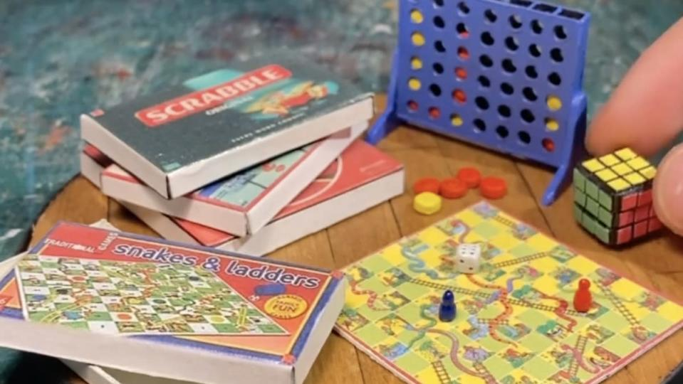 Miniature versions of famous games like Scrabble, Connect Four, and Snakes and Ladders, all together on a tiny board