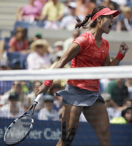 Li Na of China reacts after winning a point against Laura Robson of Great Britain during the third round of the 2013 U.S. Open tennis tournament, Friday, Aug. 30, 2013, in New York. (AP Photo/David Goldman)
