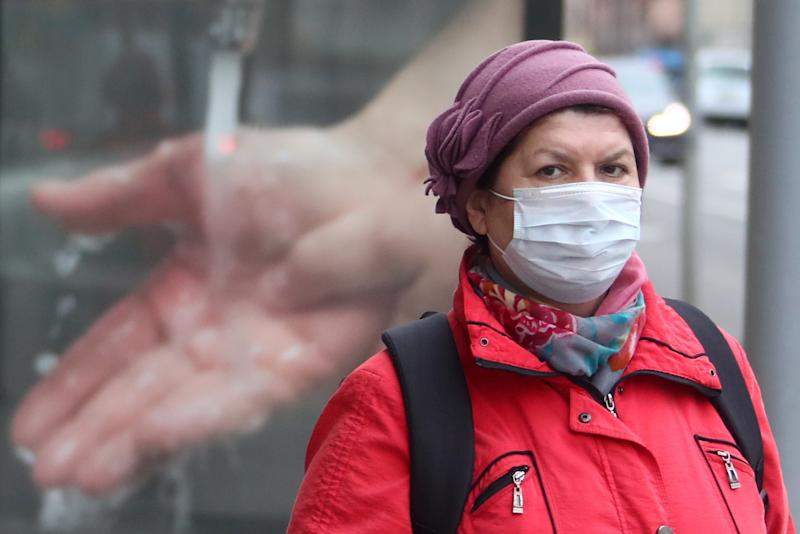 MOSCOW, RUSSIA - APRIL 6, 2020: A woman wears a face mask during a walk outside; a period off work with full pay has been extended until April 30 nationwide as part of preventive measures to contain the spread of the COVID-19 infection. Valery Sharifulin/TASS (Photo by Valery Sharifulin\TASS via Getty Images)