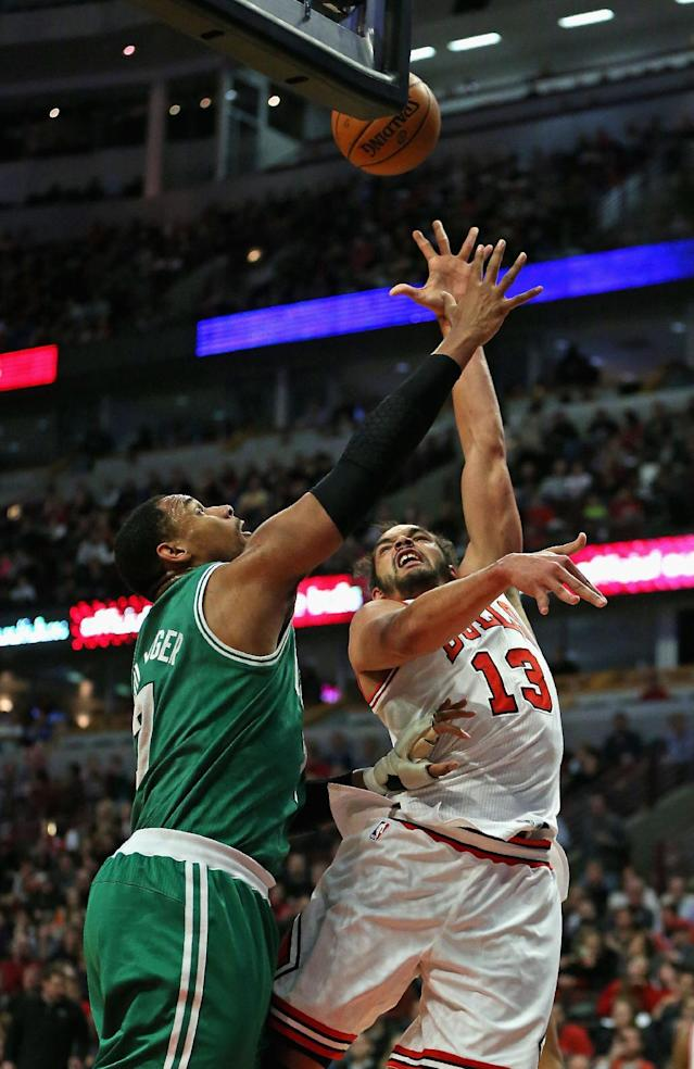 CHICAGO, IL - JANUARY 02: Joakim Noah #13 of the Chicago Bulls shoots over Jared Sullinger #7 of the Boston Celtics at the United Center on January 2, 2014 in Chicago, Illinois. The Bulls defeated the Celtics 94-82. (Photo by Jonathan Daniel/Getty Images)