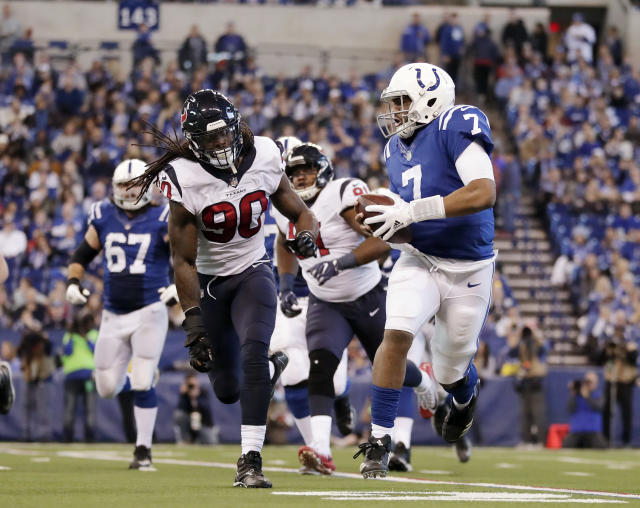 <p>Indianapolis Colts quarterback Jacoby Brissett (7) is chased by Houston Texans' Jadeveon Clowney (90) during the first half of an NFL football game, Sunday, Dec. 31, 2017, in Indianapolis. (AP Photo/Michael Conroy) </p>