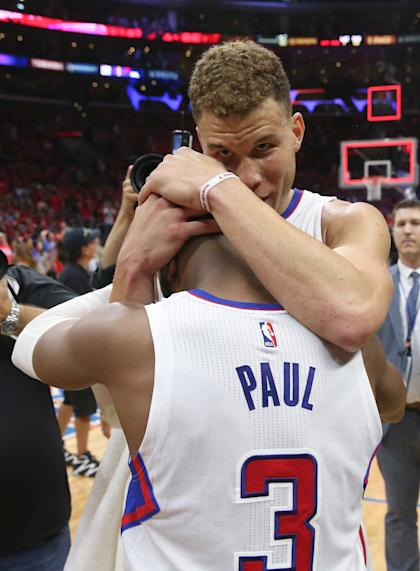 Blake Griffin and Chris Paul embrace. (Stephen Dunn/Getty Images)