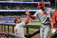 Philadelphia Phillies manager Gabe Kapler, left, celebrates with Aaron Altherr after Altherr scored on a three-run double by Aaron Nola during the fifth inning in the second game of a baseball doubleheader against the New York Mets Monday, July 9, 2018, in New York. (AP Photo/Frank Franklin II)