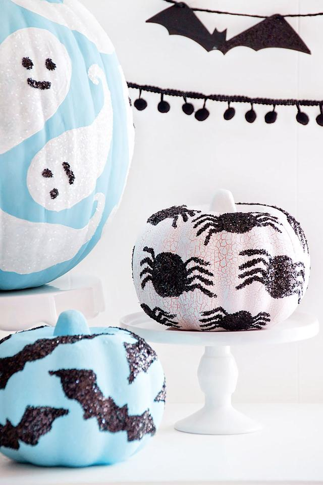 """<p>Add glitter on top of painted designs for an easy way to make your pumpkin sparkle. </p><p><strong>Get the tutorial at <a rel=""""nofollow"""" href=""""https://www.iheartnaptime.net/glitter-pumpkins/"""">I Heart Naptime</a>.</strong> </p><p><strong>Tools you'll need: </strong>assorted glitter colors, $5, <a rel=""""nofollow"""" href=""""https://www.amazon.com/ArtSkills-Supplies-Ultra-Fine-Assorted-Non-Toxic/dp/B003O6BUOC/"""">amazon.com</a>.<strong><br></strong></p>"""