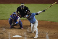 Tampa Bay Rays' Randy Arozarena watches a RBI-single against the Los Angeles Dodgers during the third inning in Game 5 of the baseball World Series Sunday, Oct. 25, 2020, in Arlington, Texas. (AP Photo/Sue Ogrocki)
