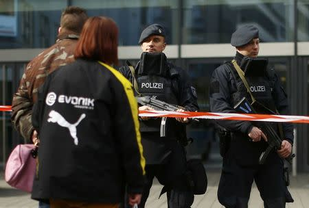 People passing-by talk to police at the Limbecker Platz shopping mall in Essen, Germany, March 11, 2017, after it was shut due to attack threat. REUTERS/Thilo Schmuelgen