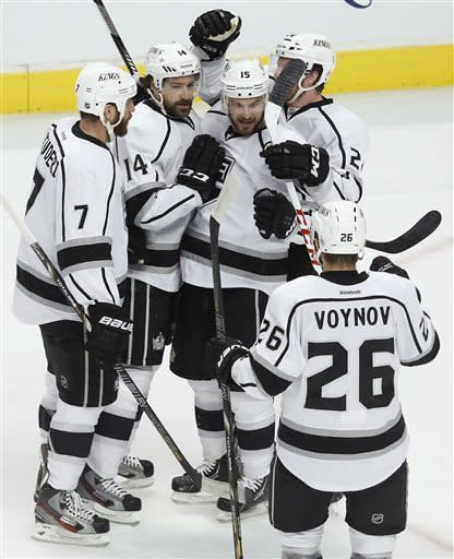 From left, Los Angeles Kings' Rob Scuderi (7), Justin Williams, Brad Richardson, Colin Fraser and Slava Voynov celebrate after Williams scored a goal against the Chicago Blackhawks during the first period in Game 1 of the NHL hockey Stanley Cup Western Conference finals Saturday, June 1, 2013, in Chicago. (AP Photo/Charles Rex Arbogast)