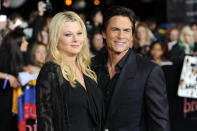 """Rob Lowe, right, and wife Sheryl Berkoff arrive at the world premiere of """"The Twilight Saga: Breaking Dawn - Part 1"""" on Monday, Nov. 14, 2011, in Los Angeles. (AP Photo/Chris Pizzello)"""