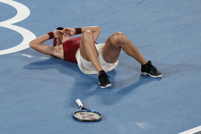 Belinda Bencic, of Switzerland, reacts after defeating Marketa Vondrousova, of the Czech Republic, in the women's gold medal match of the tennis competition at the 2020 Summer Olympics, Saturday, July 31, 2021, in Tokyo, Japan. (AP Photo/Patrick Semansky)