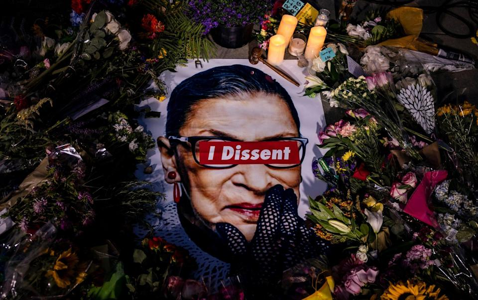 People leave mementos in a makeshift memorial for Supreme Court Justice Ruth Bader Ginsburg in front of the US Supreme Court on September 19, 2020 in Washington, DC - Samuel Corum/Getty Images