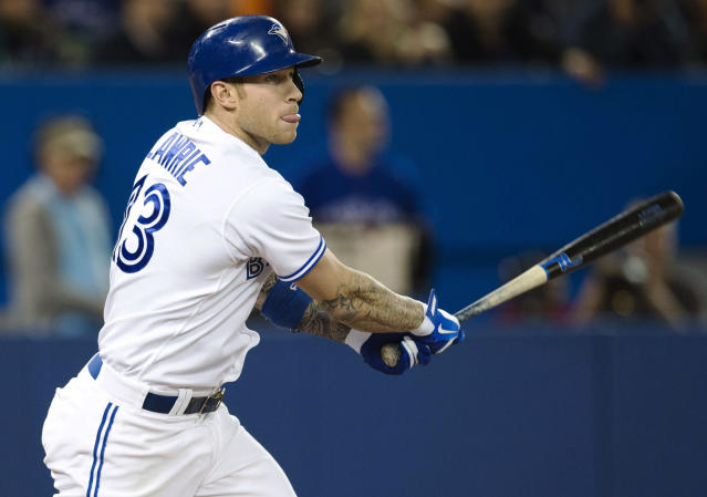 Toronto Blue Jays' Brett Lawrie hits a double against the New York Yankees during the fourth inning of MLB American League baseball action in Toronto Wednesday, Sept. 18, 2013. (AP Photo/The Canadian Press, Mark Blinch)