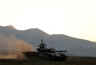 FILE PHOTO: Azerbaijani soldiers maneuver with a tank during a training at a military training and deployment center near the city of Ganja