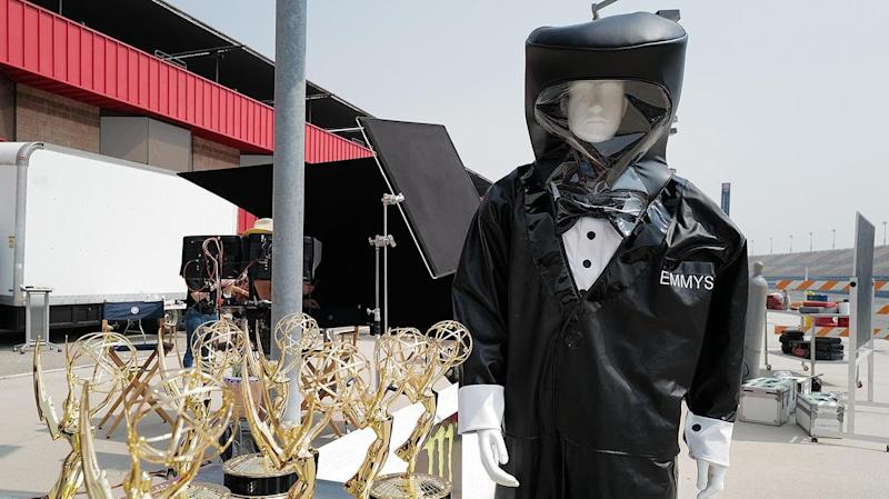 Hazmat-clad presenters may deliver trophies for some Emmy winners
