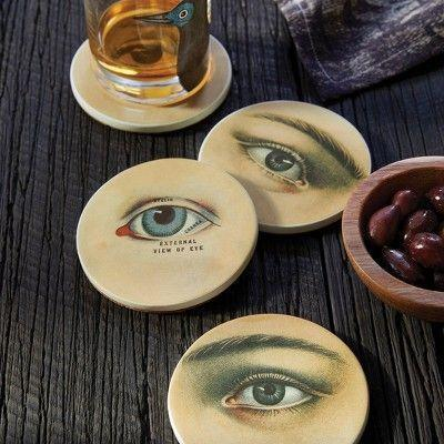 """<p><strong>John Derian for Threshold</strong></p><p>target.com</p><p><strong>$10.00</strong></p><p><a href=""""https://www.target.com/p/4pc-mysterious-gaze-ceramic-eyes-coaster-set-john-derian-for-threshold-8482/-/A-79502753"""" rel=""""nofollow noopener"""" target=""""_blank"""" data-ylk=""""slk:Shop Now"""" class=""""link rapid-noclick-resp"""">Shop Now</a></p><p>Have a sense that someone's watching you? Could be these vintage illustrated coasters–it is spooky szn after all. </p>"""