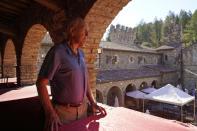 "Dario Sattui looks out over the courtyard where special events and many fundraisers are held at his Tuscan-style castle, Castello di Amorosa in Calistoga, Calif., on Thursday, Oct. 15, 2020. ""I've been in the wine business for 48 years and this is by far the most catastrophic, devastating, most horrible year,"" said Sattui, who said he lost more than 100,000 bottles of wines when the fire devoured a building near his castle. Dozens of weddings and dinner parties at V. Sattui, the winery his family established 135 years ago, were also canceled this year. (AP Photo/Eric Risberg)"