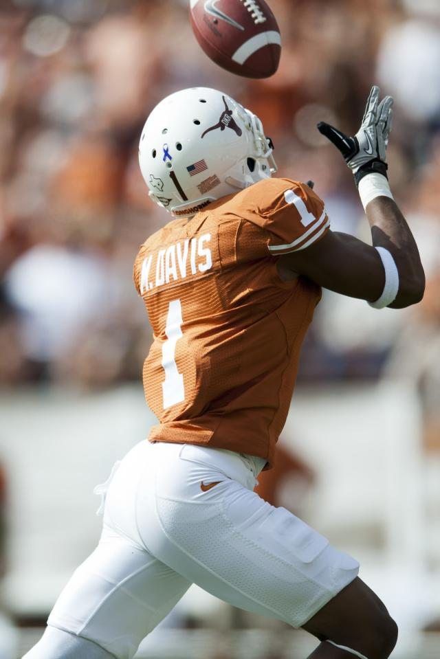 AUSTIN, TX - NOVEMBER 10: Mike Davis #1 of the Texas Longhorns catches a 61 yard touchdown pass during the Big 12 Conference game against the Iowa State Cyclones on November 10, 2012 at Darrell K Royal-Texas Memorial Stadium in Austin, Texas. (Photo by Cooper Neill/Getty Images)