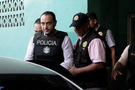 FILE PHOTO: Former governor of Mexico's Quintana Roo state Roberto Borge is escorted by policemen while leaving a court of appeals in Panama City