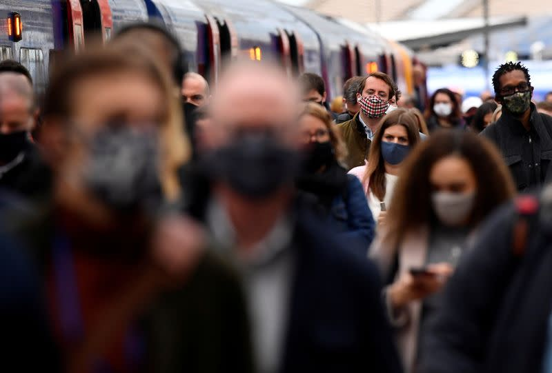 FILE PHOTO: People travel on public transport as COVID-19 restrictions continue to ease, in London