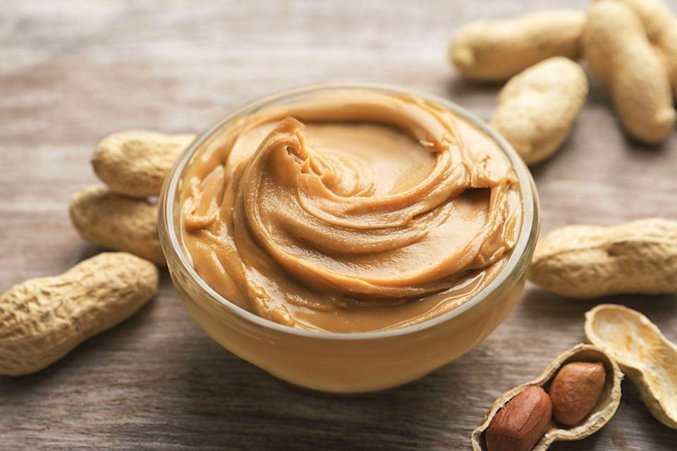 """<p>What <em>can't </em>peanut butter do?! It contains 8 grams of protein per 2 tablespoon serving plus heart-healthy unsaturated fats. Tree nuts and <a href=""""https://www.goodhousekeeping.com/home/gardening/a20706839/growing-peanuts/"""" rel=""""nofollow noopener"""" target=""""_blank"""" data-ylk=""""slk:peanuts"""" class=""""link rapid-noclick-resp"""">peanuts</a> in general (like GH Nutritionist Approved <a href=""""https://www.amazon.com/stores/HamptonFarms/node/9495128011?tag=syn-yahoo-20&ascsubtag=%5Bartid%7C10070.g.35366225%5Bsrc%7Cyahoo-us"""" rel=""""nofollow noopener"""" target=""""_blank"""" data-ylk=""""slk:Hampton Farms Peanuts"""" class=""""link rapid-noclick-resp"""">Hampton Farms Peanuts</a>) have been linked to reduced risk of chronic disease and weight loss or maintenance. Look for nut butters made from only nuts and salt with less than 140 mg of sodium per serving, though brands that use oil as a stabilizer are okay, too. Nut butter packs we love: <a href=""""https://www.amazon.com/Butter-Justins-Ingredients-Gluten-free-Responsibly/dp/B00E1XPY3A/?tag=syn-yahoo-20&ascsubtag=%5Bartid%7C10070.g.35366225%5Bsrc%7Cyahoo-us"""" rel=""""nofollow noopener"""" target=""""_blank"""" data-ylk=""""slk:Justin's"""" class=""""link rapid-noclick-resp"""">Justin's</a>, <a href=""""https://www.amazon.com/Barney-Butter-Almond-Snack-Smooth/dp/B001P22GHC?tag=syn-yahoo-20&ascsubtag=%5Bartid%7C10070.g.35366225%5Bsrc%7Cyahoo-us"""" rel=""""nofollow noopener"""" target=""""_blank"""" data-ylk=""""slk:Barney Butter"""" class=""""link rapid-noclick-resp"""">Barney Butter</a>, and <a href=""""https://www.amazon.com/Wild-Classic-Creamy-Peanut-Packets/dp/B07B9K66KJ?tag=syn-yahoo-20&ascsubtag=%5Bartid%7C10070.g.35366225%5Bsrc%7Cyahoo-us"""" rel=""""nofollow noopener"""" target=""""_blank"""" data-ylk=""""slk:Wild Friends"""" class=""""link rapid-noclick-resp"""">Wild Friends</a>. As for <a href=""""https://www.goodhousekeeping.com/food-products/g4240/best-breakfast-bars/"""" rel=""""nofollow noopener"""" target=""""_blank"""" data-ylk=""""slk:nut-based bars"""" class=""""link rapid-noclick-resp"""">nut-based bars</a>, choose ones made from 100% real fo"""