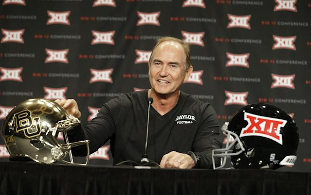 Baylor head coach Art Briles touches his teams' helmet while speaking to reporters during the NCAA college Big 12 Conference football media days in Dallas, Monday, July 21, 2014. (AP Photo/LM Otero)