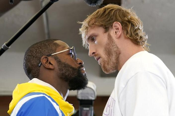 Floyd Mayweather, left, and and Logan Paul, right, face off during a press event, Thursday, June 3, 2021, in Miami Beach, Fla. Mayweather will fight Paul in an exhibition match at the Hard Rock Stadium in Miami Gardens, Fla. Sunday. (AP Photo/Lynne Sladky)
