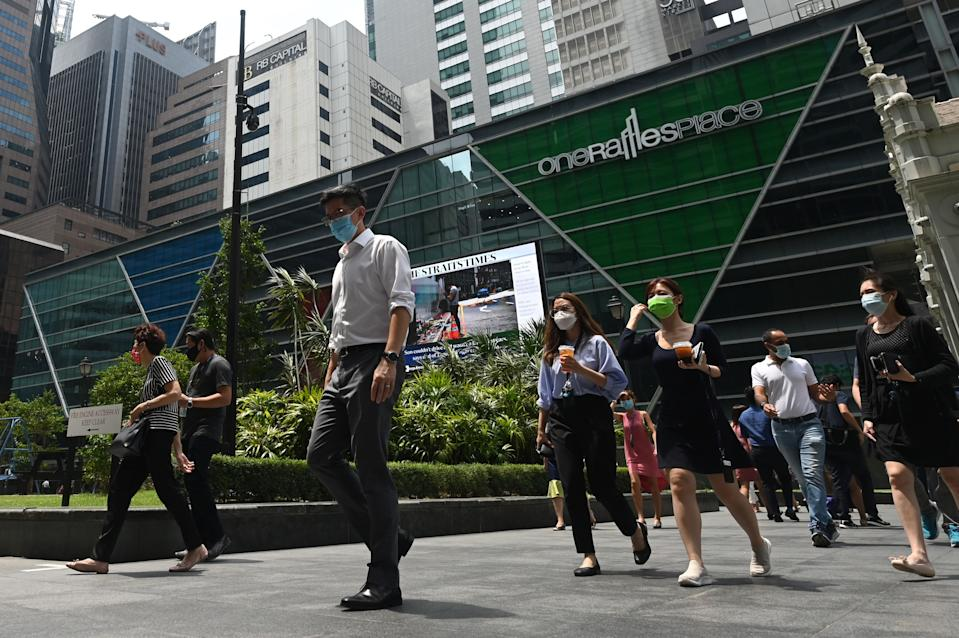 People seen in the Raffles Place financial business district in Singapore. (PHOTO: Getty Images)