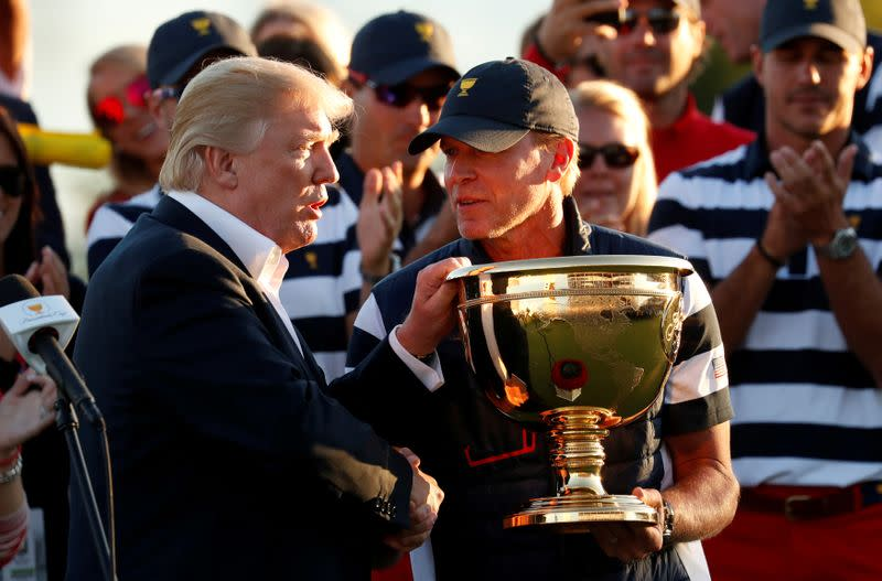 FILE PHOTO: U.S. President Donald Trump attends the Presidents Cup golf tournament in New Jersey