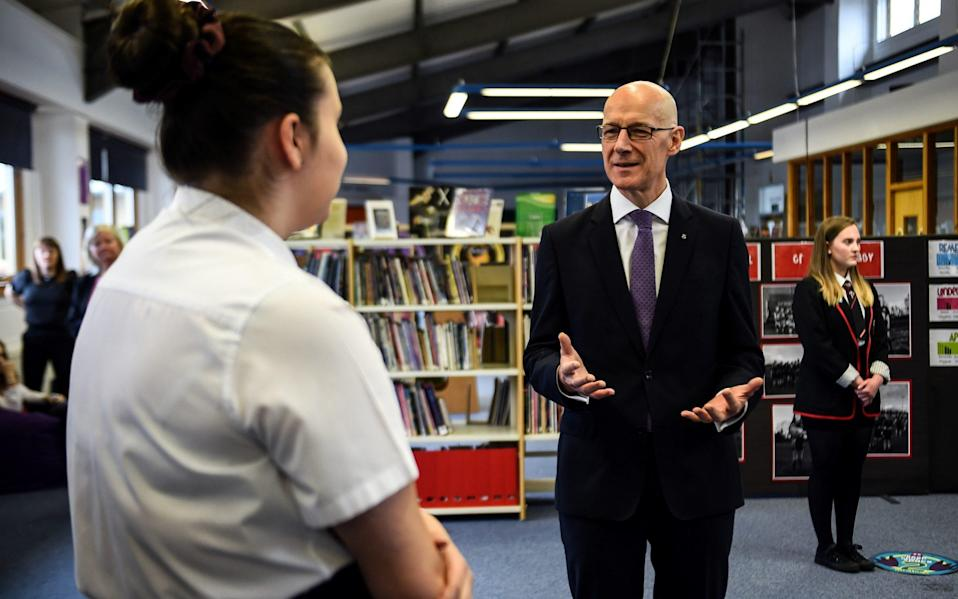 John Swinney claimed in the summer that surveillance of school children through testing would take place - Andy Buchanan/ REUTERS