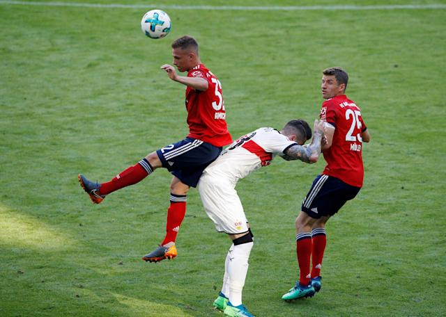 Soccer Football - Bundesliga - Bayern Munich v VfB Stuttgart - Allianz Arena, Munich, Germany - May 12, 2018 Bayern Munich's Joshua Kimmich and Thomas Mueller in action with Stuttgart's Daniel Ginczek REUTERS/Michaela Rehle DFL RULES TO LIMIT THE ONLINE USAGE DURING MATCH TIME TO 15 PICTURES PER GAME. IMAGE SEQUENCES TO SIMULATE VIDEO IS NOT ALLOWED AT ANY TIME. FOR FURTHER QUERIES PLEASE CONTACT DFL DIRECTLY AT + 49 69 650050