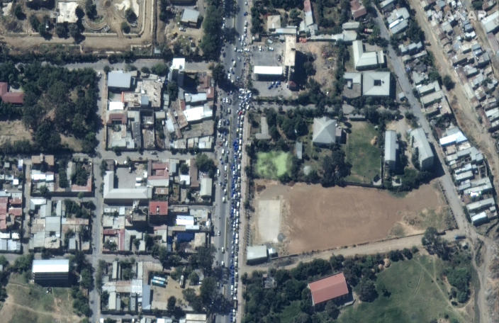 """This satellite image taken Monday, Nov. 23, 2020 and released by Maxar Technologies, shows vehicles queuing for fuel in Mekele, the capital of the Tigray region of Ethiopia. Ethiopia's prime minister is rejecting growing international consensus for dialogue and a halt to deadly fighting in the Tigray region as """"unwelcome,"""" saying his country will handle the conflict on its own as a 72-hour surrender ultimatum runs out on Wednesday. (Maxar Technologies via AP)"""