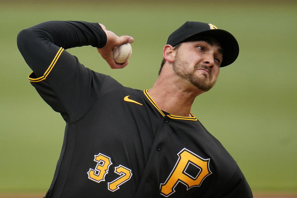 Pittsburgh Pirates starting pitcher Chase De Jong delivers during the second inning of a baseball game against the Colorado Rockies in Pittsburgh, Sunday, May 30, 2021. (AP Photo/Gene J. Puskar)