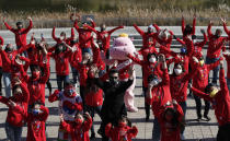 Participants shout slogans during a campaign to express their support to the global community efforts to overcome the coronavirus in Seoul, South Korea, Saturday, Oct. 24, 2020. (AP Photo/Lee Jin-man)