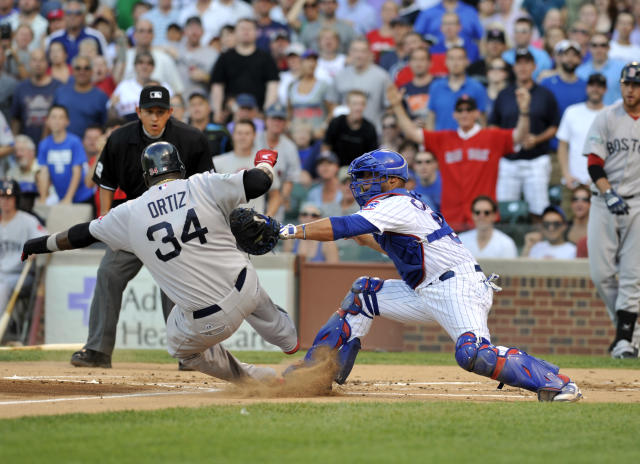 CHICAGO, IL - JUNE 16: David Ortiz #34 of the Boston Red Sox is tagged out at home by Welington Castillo #53 of the Chicago Cubs in the first inning on June 16, 2012 at Wrigley Field in Chicago, Illinois. (Photo by David Banks/Getty Images)