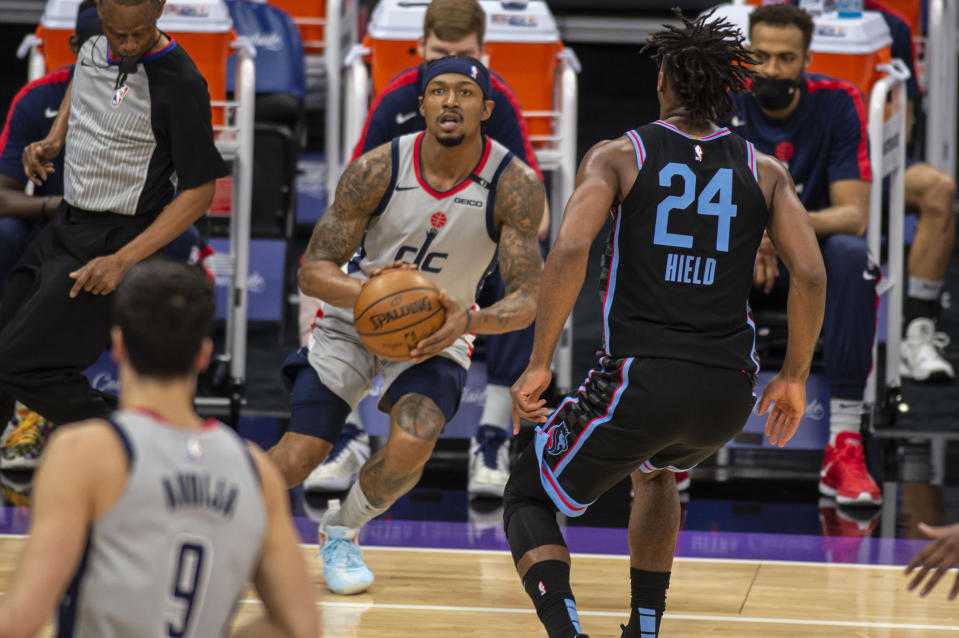 Washington Wizards guard Bradley Beal (3) prepares to hit a three point basket in front of Sacramento Kings guard Buddy Hield (24) during the first quarter of an NBA basketball game in Sacramento, Calif., Wednesday, April 14, 2021. (AP Photo/Hector Amezcua)