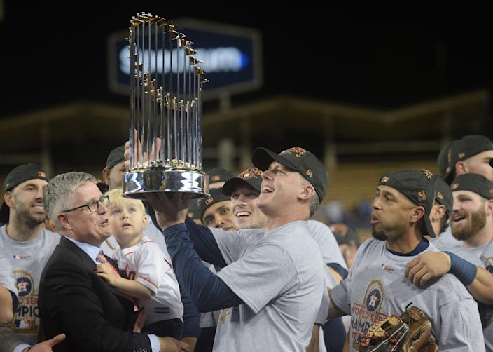 Houston Astros manager A.J. Hinch is presented with the Commissioner's Trophy after defeating the Los Angeles Dodgers in Game 7 of the World Series at Dodger Stadium, Nov. 1, 2017.