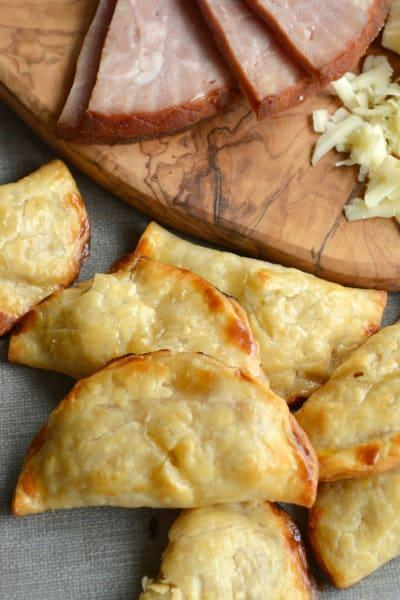 "<p>Buttery, flakey and perfect for brunch or breakfast on the go! These ham and cheese hand pies are a cinch to make, especially if you use store bought pie crust.<br>Get the recipe <a href=""https://www.foodfanatic.com/2015/05/easy-ham-and-cheese-handpies/"" rel=""nofollow noopener"" target=""_blank"" data-ylk=""slk:here"" class=""link rapid-noclick-resp""><strong>here</strong></a><br>[Photo: Food Fanatic] </p>"