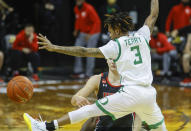 Oregon guard Jalen Terry (3), attempts to block a pass by a Utah player during an NCAA college basketball game in Eugene, Ore., Saturday, Feb. 20, 2021 (AP Photo/Thomas Boyd)
