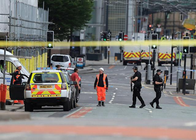 <p>Police guard close to the Manchester Arena in Manchester, Britain, Tuesday May 23, 2017, a day after an explosion. (Peter Byrne/PA via AP) </p>