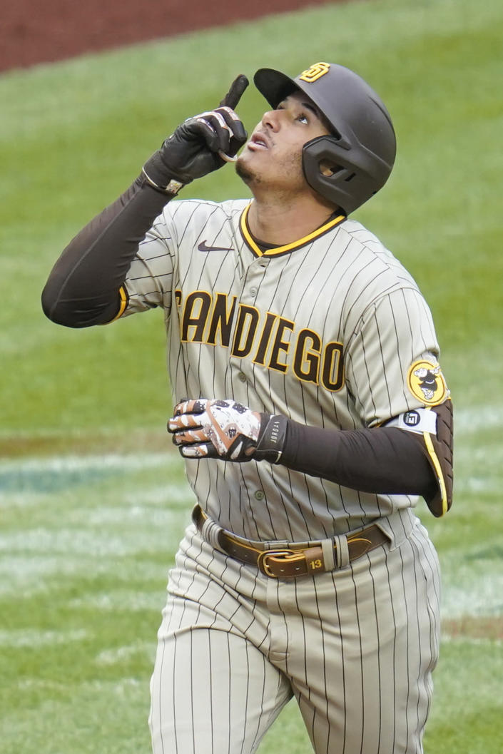 San Diego Padres' Manny Machado points skyward as he heads home after hitting a home run against the Pittsburgh Pirates in the first inning of a baseball game, Thursday, April 15, 2021, in Pittsburgh. (AP Photo/Keith Srakocic)