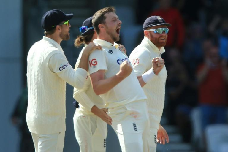 Elation - England's Ollie Robinson (C) celebrates with team-mates after dismissing India captain Virat Kohli on the fourth day of the third Test at Headingley on Saturday (AFP/Lindsey Parnaby)