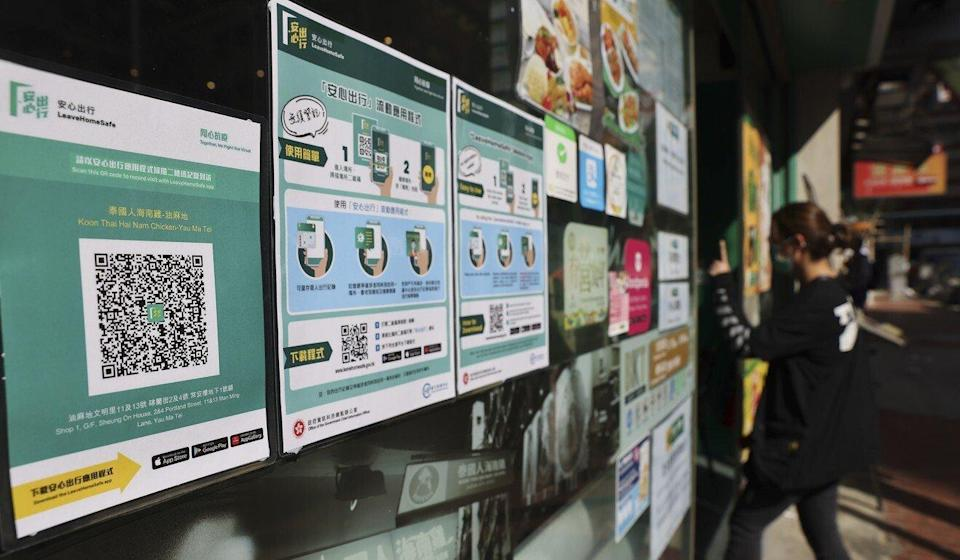 An eatery displays a QR code for the Leave Home Safe Covid-19 risk-notification app. Photo: Nora Tam