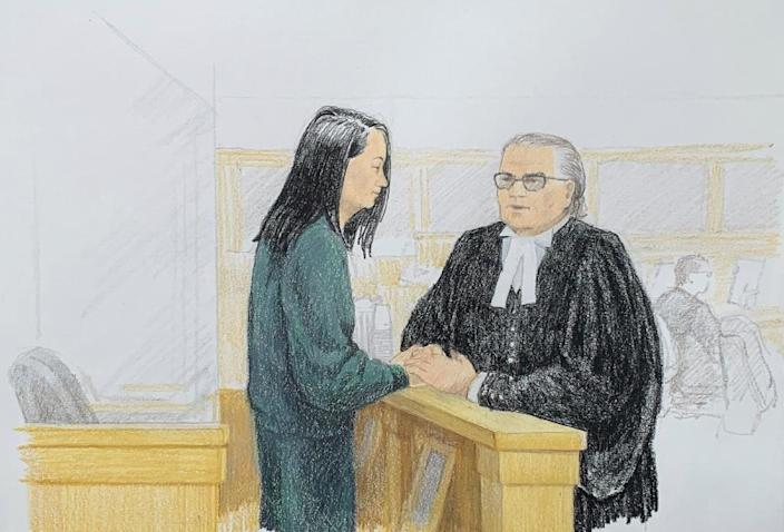 In this courtroom sketch by Jane Wolsak and released to AFP by the artist, Meng Wanzhou (L), Huawei's chief financial officer, speaks with lawyer David Martin in the courtroom in Vancouver, British Columbia in December 2018 (AFP Photo/Jane Wolsak)