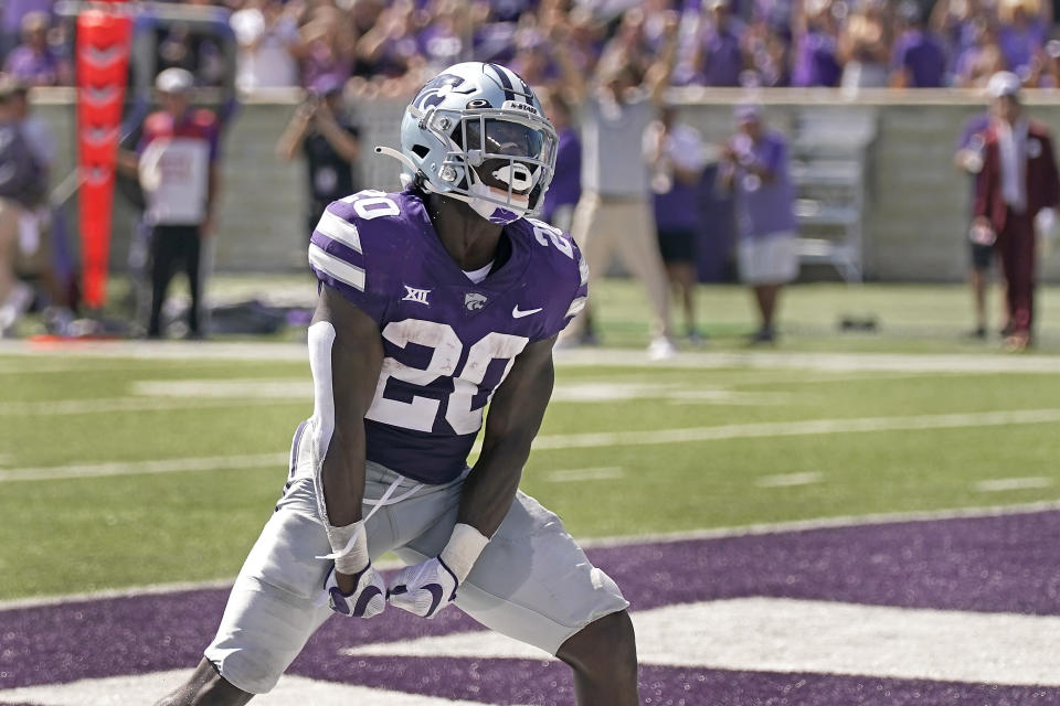Kansas State running back Joe Ervin (20) celebrates after scoring a touchdown during the first half of an NCAA college football game against Nevada on Saturday, Sept. 18, 2021, in Manhattan, Kan. (AP Photo/Charlie Riedel)