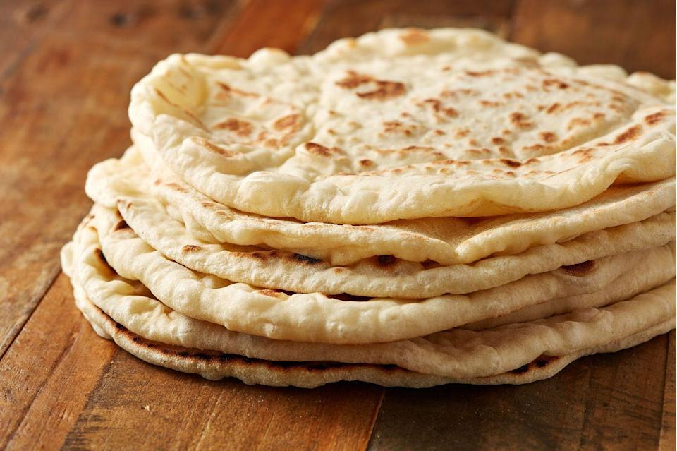 """<p>Originating in the Middle East, <a href=""""https://www.delish.com/cooking/recipe-ideas/a28143766/homemade-pita-bread/"""" rel=""""nofollow noopener"""" target=""""_blank"""" data-ylk=""""slk:pita"""" class=""""link rapid-noclick-resp"""">pita</a> is a leavened flatbread made of wheat flour. They are cooked at high temperatures, causing the liquid in the dough to escape. This forms a large air bubble in the center, which becomes a pocket when cut in half — great for a hand-held falafel sandwich. They're also perfect for dipping when cut into wedges and toasted. </p><p>Try it with this easy <a href=""""https://www.delish.com/cooking/recipe-ideas/recipes/a46275/baked-reuben-dip-recipe/"""" rel=""""nofollow noopener"""" target=""""_blank"""" data-ylk=""""slk:Homemade Falafel"""" class=""""link rapid-noclick-resp"""">Homemade Falafel</a> recipe from Delish.</p>"""