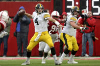 Iowa quarterback Nate Stanley (4) throws a pass in front of Nebraska defensive lineman Carlos Davis (96) during the first half of an NCAA college football game in Lincoln, Neb., Friday, Nov. 29, 2019. (AP Photo/Nati Harnik)
