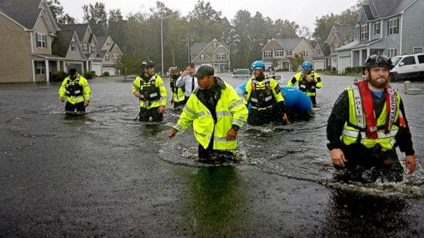 PHOTO: Members of the North Carolina Task Force urban search and rescue team wade through a flooded neighborhood looking for residents who stayed behind as Hurricane Florence continues to dump heavy rain in Fayetteville, N.C., Sept. 16, 2018. (David Goldman/AP)