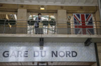 A passengers waits at Eurostar Terminal of the Gare du Nord train station in Paris, Friday, Aug. 14, 2020. British holidaymakers in France were mulling whether to return home early Friday to avoid having to self-isolate for 14 days following the U.K. government's decision to reimpose quarantine restrictions on France amid a recent pick-up in coronavirus infections. (AP Photo/Michel Euler)