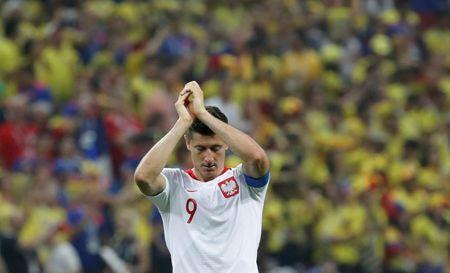 Soccer Football - World Cup - Group H - Poland vs Colombia - Kazan Arena, Kazan, Russia - June 24, 2018 Poland's Robert Lewandowski looks dejected as he applauds the fans at the end of the match REUTERS/Toru Hanai