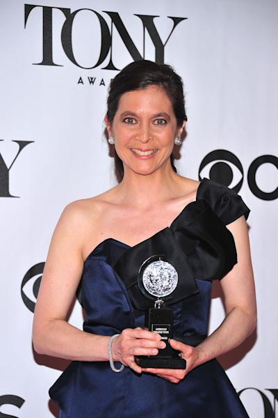 """Diane Paulus poses with her award for best direction in a musical for """"Pippin"""" at the 67th Annual Tony Awards, on Sunday, June 9, 2013 in New York. (Photo by Charles Sykes/Invision/AP)"""
